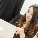 EMLV student on her laptop